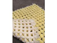 Lemon and white Pom Pom blanket