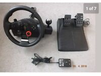 Logitech GT Driving Force Steering Wheel with pedals for PS3. Includes Gran Turismo 5 game.