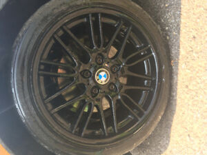 Black BMW M series rims with low profile tires