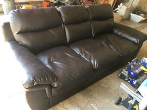 Leather couch, dark brown in color