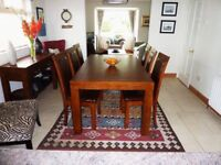 Oak dinning table and six matching chairs