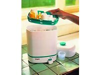Tomy steriliser in perfect condition, complete with six Avent bottles. £12