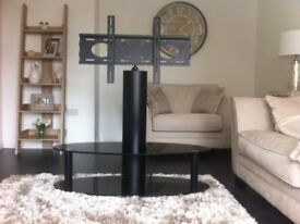 Black glass free standing TV stand with two shelves