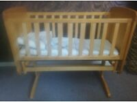 Mamas and papas baby crib/rocker. Light brown wood-great condition-mattress-nude bumper set!