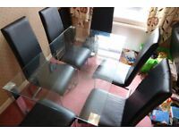 Glass Dining Table with 6 Black Leather Chairs *sold together*