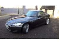 classic Honda S2000 in black with red leather interior