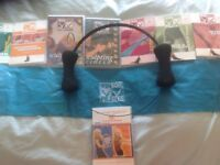 9 PILATES DVD's WITH SCULPTING CIRCLE & RESISTANCE BAND ALL IN EXCELLENT CONDITION, ONE UNOPENED .