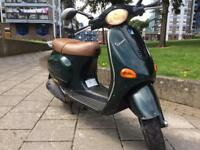 Vespa et4 125 good runner £695 make offers