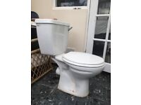 Toilet with cistern included