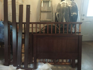 Dark brown twin bed frame with side rails