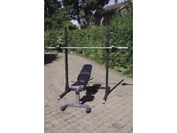 Squat rack with adjustable bench and weights - gym equipment