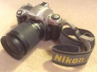 Nikon F65 with 28-100mm lens and 70-300mm lens (anti glare cap)