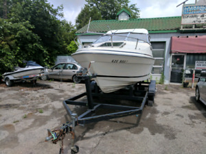 Needs a Chev 305 but a solid boat