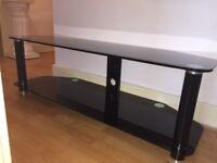 Black glass TV stand chrome