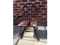 Child's vintage stick back rocking chair