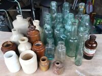 Stone jars and glass antique bottles