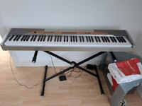 Digital Piano - 88 Weighted keys - Used but in perfect working order! Stand & accessories included!