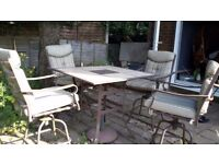 Garden dining table and four chairs.