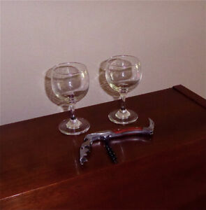 Waiter's corkscrew and two wine glasses