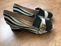 Gucci heeled loafers used once