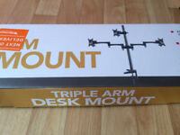 Selling this brand new triple arm desk mount.