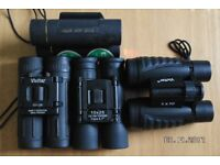 Binoculars set of four for £10.00. Two vivitar and Two other Brands.