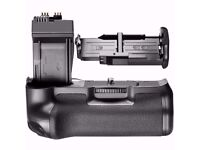 Canon extended battery grip, 2 batteries and USB charger.