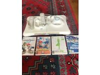 Nintendo Wii with Wii fit game, board, Wii Sports, Mario Kart games, 2 controls & Steering Wheels
