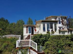 310 000$ - Maison à un étage et demi à Jonquière (Lac-Kénog