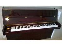 Reid-Sohn upright mahogany piano in excellent condition