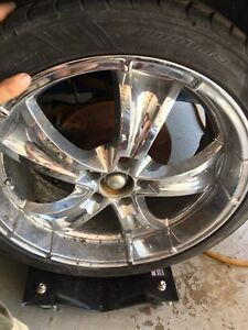 20 inch chrome wheels w/tires.