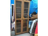 Oak style double door glazed bookcase and sideboard