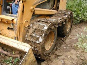 * RUBBER AND STEEL OVER THE TIRE TRACK FOR SKID STEER LOADERS *
