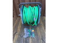 Hose pipe with reel and fittings