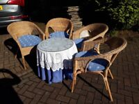 Set of 4 matching wicker chairs with seat pads