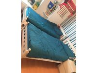 2 white single beds with silent night mattresses