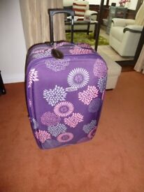 large flowered suitcase in excellent condition
