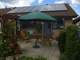Large Wind Up Patio Umbrella with Heavy Base. Only 3 days old! I can't cope with it. Help!