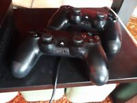 Playstation 4 with 2 controllers and 3 games including Fifa, Metal Gear Solid V & Assassins Creed