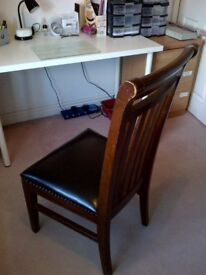 THREE DARK WOOD DINING CHAIRS WITH FAUX LEATHER SEATS