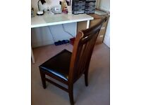 FOUR DARK WOOD DINING CHAIRS WITH FAUX LEATHER SEATS