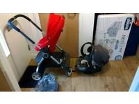 Red Stokke scoot with car seat