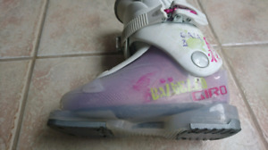Pair of white-and-pink ski boots