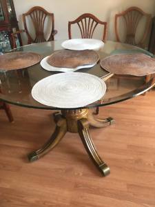 Modern wooden dining table with glass top