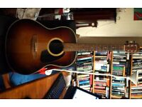 Guitar. Applause acoustic roundback guitar