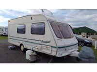 Swift caravan 4 birth in excellent condition comes with porch awning and many more extras.