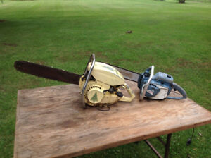 Two antique/vintage chainsaws