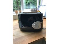 Brand new Buxton black 2 slice toaster,reheats,frozen cancel button.never used before