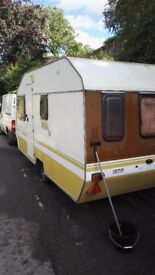 Caravan. Some damp in front corner. Comes with lots of accessories. Does tow.