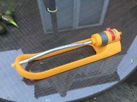 Hozelock yellow oscillating lawn sprinkler